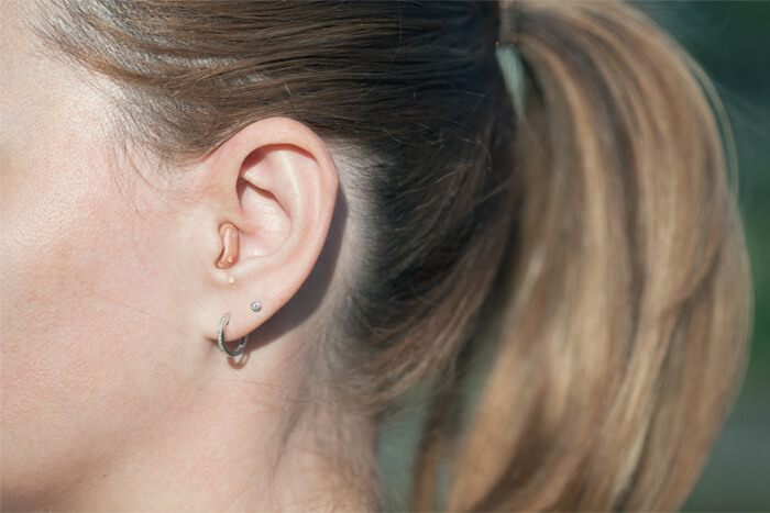 A woman with hearing aids