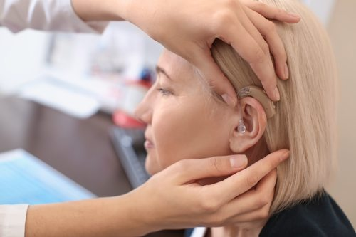 A woman being fitted with a hearing aid