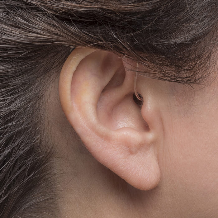 a woman with an ITC hearing aid
